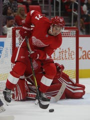 Red Wings' Dylan Larkin clears the puck against the Bruins in the second period of the Little Caesars Arena exhibition opener in Detroit on Sept. 24, 2017.