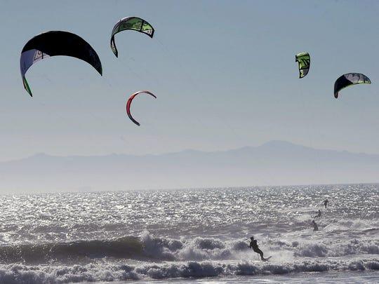 Kite board surfers enjoy idyllic conditions at Surfers