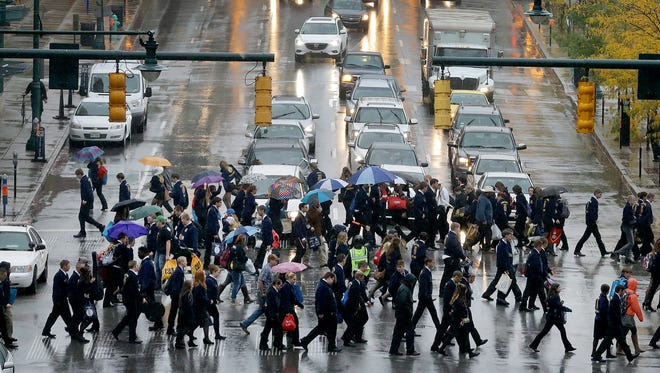 Thousands of Future Farmers of America kids make their way from Bankers Life Fieldhouse to the Indiana Convention Center along Georgia Street as rush hour traffic waits at the stoplight on Illinois Street Thursday, Oct 20, 2016, afternoon downtown Indianapolis.