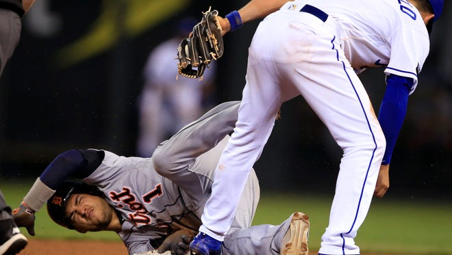 Tigers shortstop Jose Iglesias (1) is tagged out by Royals second baseman Whit Merrifield (15) during the eighth inning of the Tigers' 1-0 loss Tuesday in Kansas City, Mo.