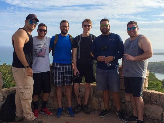 Alex Veglia, second from left, stands atop an old Spanish lookout in Guánica, Puerto Rico before Hurricane Maria struck.