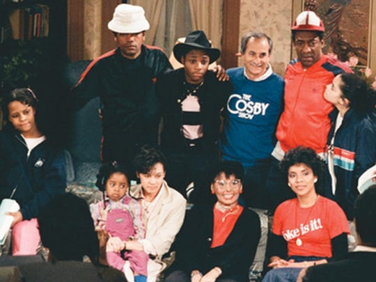 Jay Sandrich and the cast of 'The Cosby Show' in 1986