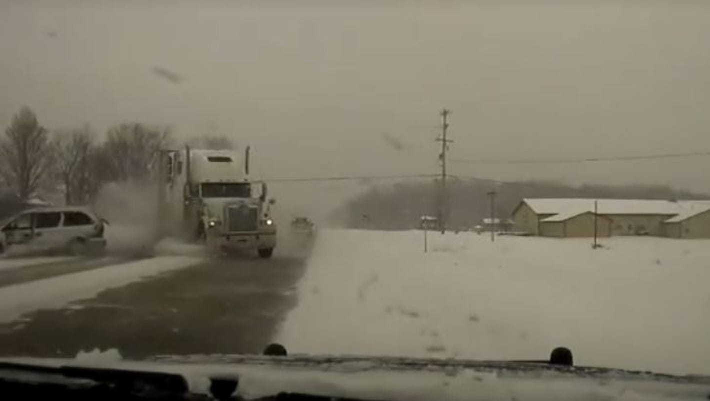 VIDEO: Kent County officer narrowly avoids head-on collision with semi