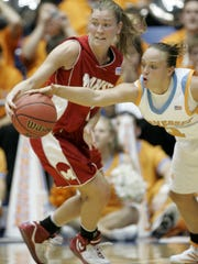 In this MArch 25, 2007 file photo, Tennessee guard Cait McMahan, right, reaches in as Marist guard Alisa Kresge dribbles during the NCAA tournament in Dayton, Ohio.