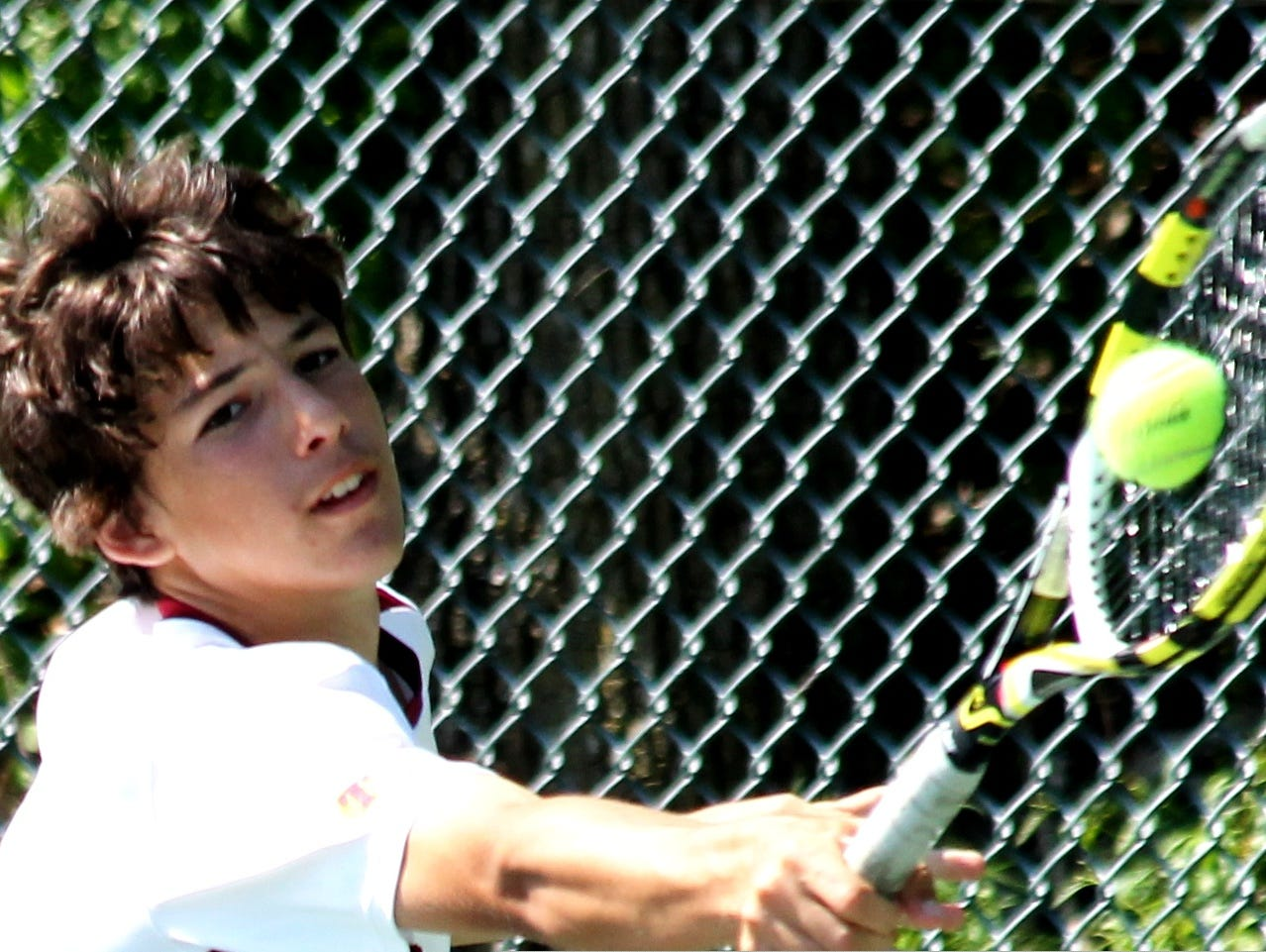 Turpin's Andrej Novakovic lunges to return a backhand against Walnut Hills in May of 2014.