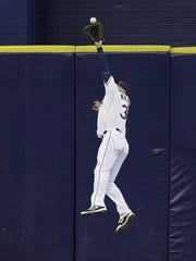 Tampa Bay's Kevin Kiermaier makes a leaping catch on