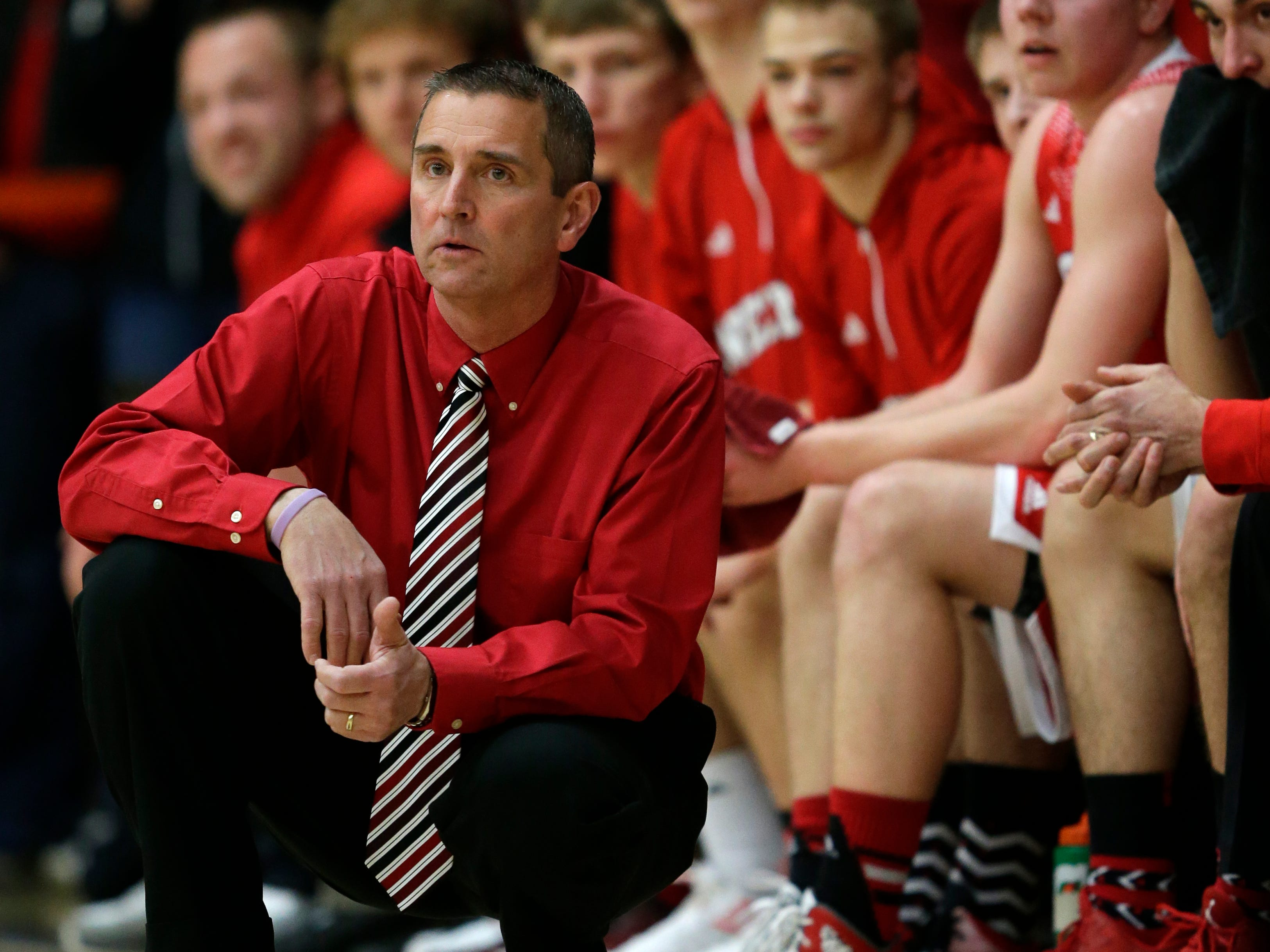 Scott Bork, who had a 64-12 record in three seasons as head boys' basketball coach at Neenah High School, resigned from his coaching position Tuesday.