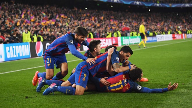 Sergi Roberto of Barcelona (obscured) celebrates with teammates as he scores their sixth goal during the UEFA Champions League Round of 16 second leg match between FC Barcelona and Paris Saint-Germain at Camp Nou on March 8 in Barcelona, Spain.