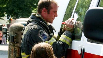 Rochester firefighter Greg Drew from Rescue 11 signs an autograph for a little girl back in 2009.