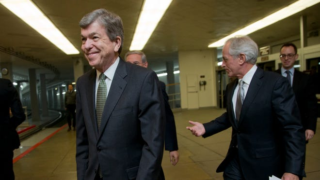 Sen Roy Blunt, R-Mo., left, walks from the Senate subway on Capitol Hill on Dec. 12, 2014.