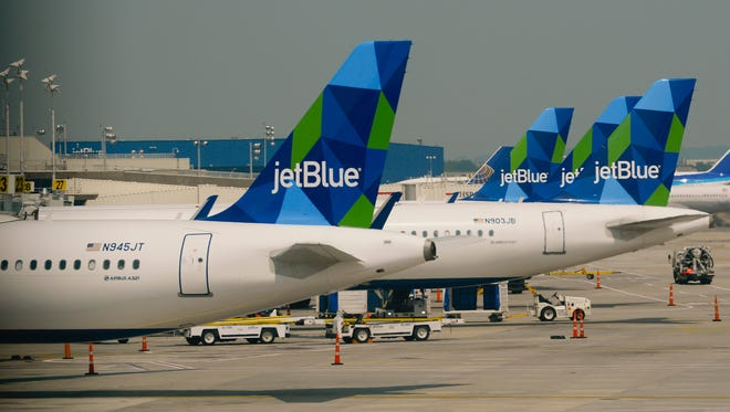 Jet Blue planes at gates at New York's JFK Airport on June 11, 2015.