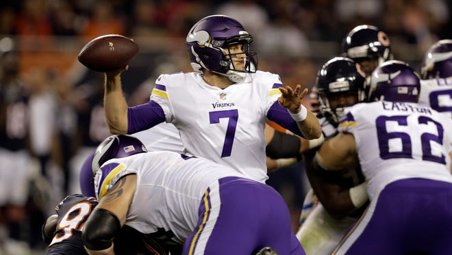 Minnesota Vikings quarterback Case Keenum (7) throws a pass during the first half of an NFL football game against the Chicago Bears, Monday, Oct. 9, 2017, in Chicago.