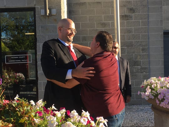 Anthony DiPippo hugs supporters after being acquitted