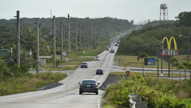 Cars make their way down Route 3 in Dededo on Jan. 30. The road will be widened to a five-lane highway as part of the military buildup in Guam.