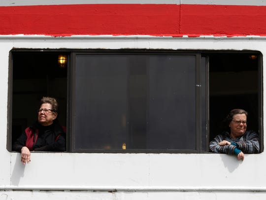 Two passengers look out from the S.S. Badger window
