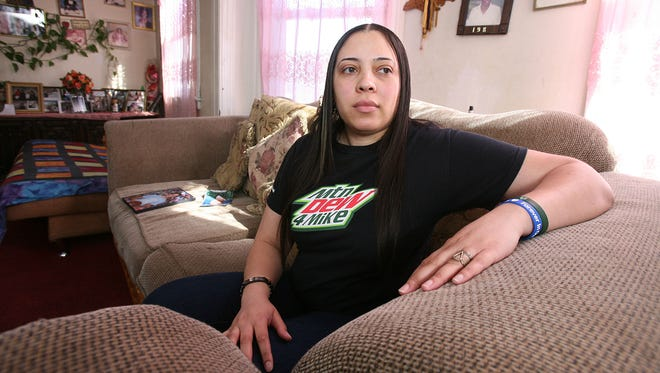 Alexandria Bodden, the half-sister of Michael Graham, is seen Thursday, Feb. 27, 2014, in her apartment in the Bronx, N.Y. Michael Graham died of a self-inflicted gunshot wound from one of their father's illegal guns.
