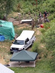 In this aerial photo, investigators look for evidence