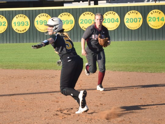 Menard's Madalyn Mahfouz (5, left) heads for second against Ouachita's Alyssa Allen (7, right) Saturday.