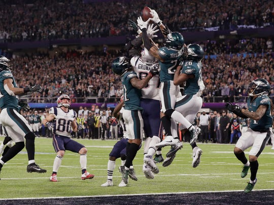 New England Patriots tight end Rob Gronkowski (87) together with Philadelphia Eagles free safety Rodney McLeod (23) and cornerback Jaylen Watkins (26) jump for a pass in the end zone, during the second half of the NFL Super Bowl 52 football game, Sunday, Feb. 4, 2018, in Minneapolis. The Eagles won 41-33. (AP Photo/Tony Gutierrez)