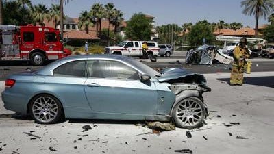 A BMW 328i was destroyed after colliding with another car on June 18, 2013, in Rancho Mirage. Investigators say its driver was street racing on Highway 111 just before the collision. The BMW's driver, Wade Wheeler, is in court Friday.