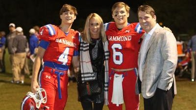 QB Jackson Muschamp (No. 6) next to his father, South Carolina coach Will Muschamp, and his mother Carol, alongside brother Whit (No. 4) after a Hammond football game. (Photo courtesy of Jackson Muschamp).
