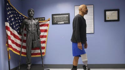 Veteran Lloyd Epps walks after doctors serviced his leg earlier this year at the VA hospital in Manhattan.