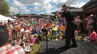 Texas Governor Rick Perry gets pumped up at The Des Moines Register Soapbox at the Iowa State Fair Tuesday, Aug. 12, 2014.