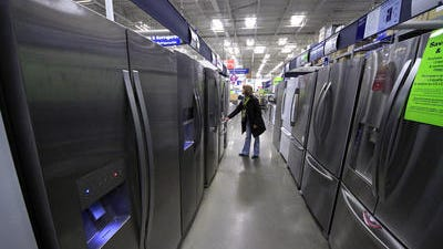 In this Thursday, Jan. 16, 2014, file photo, a woman walks through a display of refrigerators at a Lowe's store in Cranberry Township, Pa. In this Thursday, Jan. 16, 2014, file photo, a woman walks through a display of refrigerators at a Lowe's store in Cranberry Township, Pa.  Orders for durable goods increased 2.2 percent last month following a 1.3 percent drop in January, the Commerce Department reported Wednesday. The February rebound was led by a 13.6 percent surge in orders for commercial aircraft. Orders for motor vehicles and parts rose 3.6 percent, recovering from a January decline.