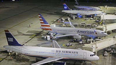 American Airlines and US Airways have pulled their fares from online travel agency Orbitz.