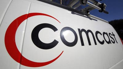 This Feb. 11, 2011, file photo, shows the Comcast logo on one of the company's vehicles, in Pittsburgh. Comcast plans to sell some cable systems to competitor Charter Communications Inc., to help ComcastÂ?s acquisition of Time Warner Cable clear regulatory hurdles, the company announced Monday, April 28, 2014.