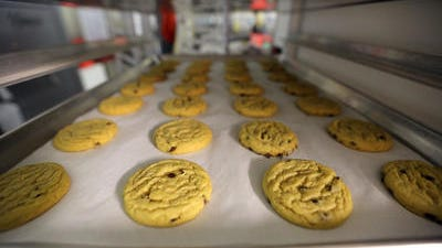 Freshly baked cannabis-infused cookies cool on a rack inside Sweet Grass Kitchen, a well-established gourmet marijuana edibles bakery which sells its confections to retail outlets, in Denver. Sweet Grass Kitchen, like other cannabis food producers in the state, is held to rigorous health inspection standards, and has received praise from inspectors, according to owner Julie Berliner.