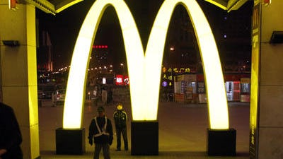 In this photo taken Saturday, May 21, 2011, a giant logo of fast food restaurant McDonald's is displayed at a train station in Shenyang in northern China's Liaoning province. McDonald?s and KFC in China faced a new food safety scare Monday, July 21, 2014 after a Shanghai television station reported a supplier sold them expired beef and chicken.