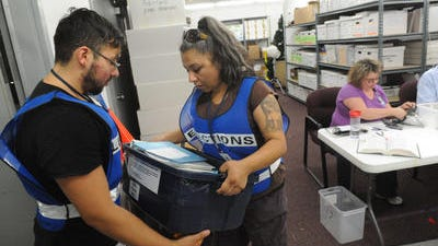Election materials arrive to the Washoe County complex Tuesday evening.