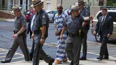 Dante Taylor in 2013 was escorted to Wyane County Court with New York State Police