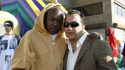 Sammy El Jamal, at right, in a 2006 photo with rapper Jadakiss in Yonkers at the grand opening of one of his car washes. El Jamal is now fighting a $4.75 million jury verdict in a civil case brought by a former employee.