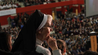 A nun watches as thousands of private school students pack into the Westchester County Center in White Plains for November 2013  rally to support legislation that would give tax credits for donations to private andreligious schools.