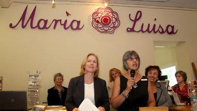 U.S. Sen. Kirsten Gillibrand, left, and Maria Luisa Whittingham, owner of Maria Luisa Boutique, host a 2012 press conference in the small Nyack boutique to announce the push for a federal bill to extend tax breaks to small businesses,