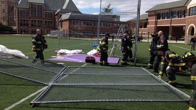A gust of wind blew down a protective fence on five New Rochelle girls discus throwers Saturday.
