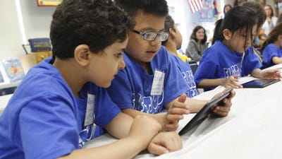 Abanoub Misseha and Edwin Lopez use an IBM reading software program called Reading Companion at East Ramapo's Fleetwood Elementary School.