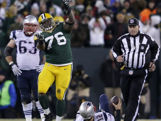 Green Bay Packers' Mike Daniels celebrates after sacking