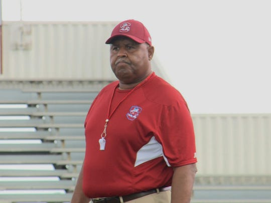 South Carolina State head football coach Buddy Pough watches his team go through Friday's practice.