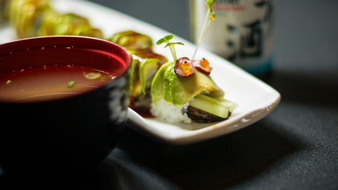 Nigori sake and the caterpillar roll with a bowl of miso soup.