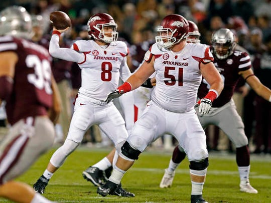 Arkansas quarterback Austin Allen (8) passes against Mississippi State while Arkansas offensive lineman Hjalte Froholdt (51) protects him during the first half of an NCAA college football game against in Starkville, Miss., Saturday, Nov. 19, 2016.