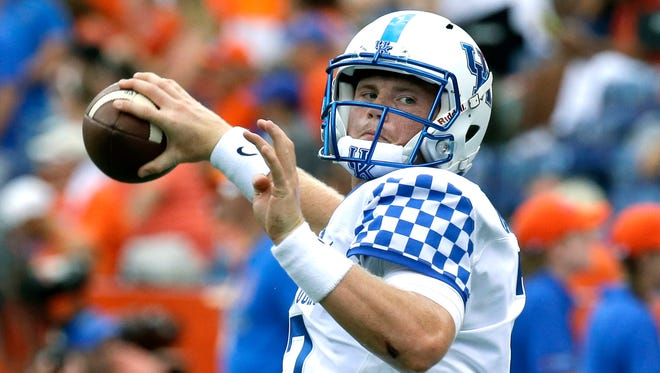 Kentucky quarterback Drew Barker warms up before an NCAA college football game against Florida, Saturday, Sept. 10, 2016, in Gainesville, Fla. (AP Photo/John Raoux)