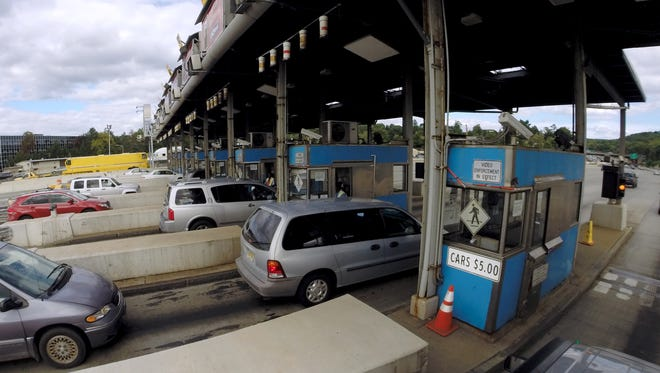 Cars pull into the toll booths in Tarrytown after crossing the Tappan Zee Bridge Aug. 27, 2015.