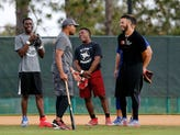 MLB Hall of Famer Barry Larkin talks with a group of MLB prospects between fielding drills at the ESPN Wide World of Sports Complex in Orlando, Fla., on Friday, Dec. 8, 2017.