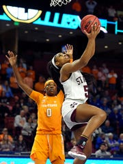 Mississippi State's Anriel Howard (5) drives in for layup past Tennessee's Rennia Davis during the first half of an NCAA college basketball game at the Southeastern Conference women's tournament, Friday, March 8, 2019, in Greenville, S.C. (AP Photo/Richard Shiro)