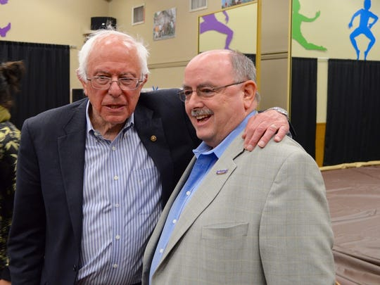 Vermont Sen. Bernie Sanders works Cathedral City Council member Greg Pettis, an undeclared delegate, for his vote during a rally at Kimball Park in National City on May 21, 2016.