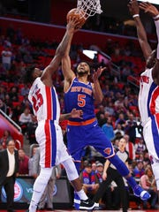 Knicks guard Courtney Lee tries to get a shot off past Pistons forward Reggie Bullock during the second half of the 104-101 win over the Knicks on Friday, Dec. 22, 2017, at Little Caesars Arena.