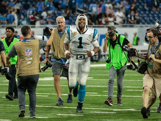 Carolina Panthers quarterback Cam Newton runs off the field after defeating the Detroit Lions, 27-24, at Ford Field in Detroit, Sunday, Oct. 8, 2017.